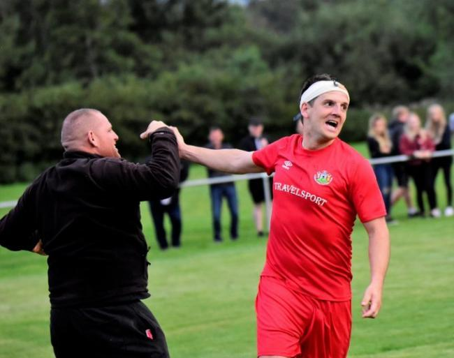 Owain Roberts celebrates his late winner for Denbigh Town against St Asaph City (Photo by Steve Whitfield)