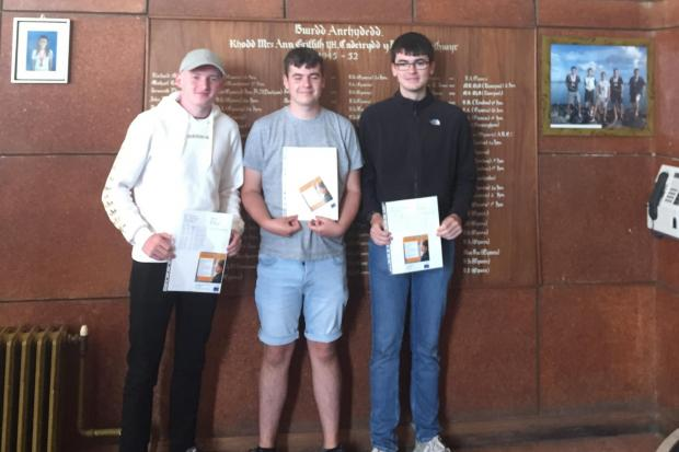 Luke Jordan, Llyr Jones and Iwan Pritchard after receiving their results.