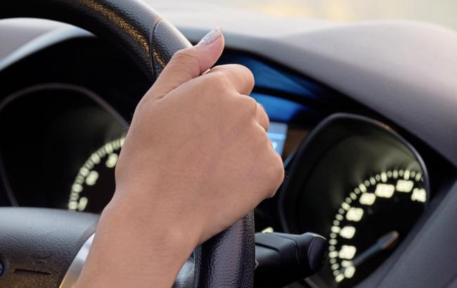 A generic photo of a person behind the steering wheel