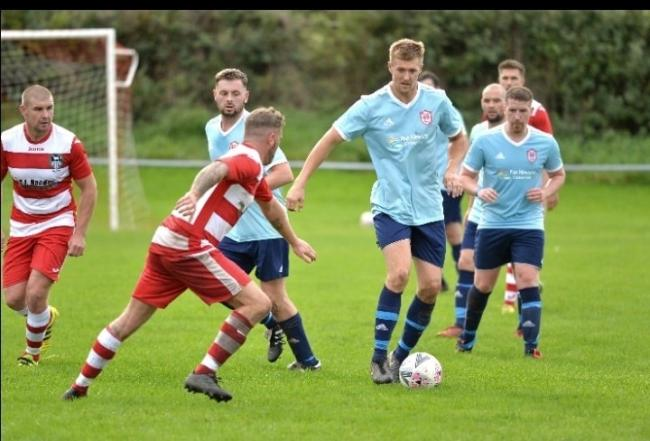 Action from Prestatyn Sports' win over Llandudno Albion (Photo by Damon Mead)