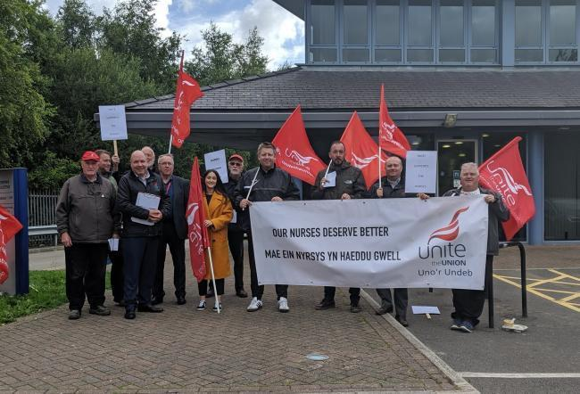 Members of Unite Wales protest outside outside a BCUHB meeting at Conwy Business Centre. Picture: Liam Randall (Local Democracy Reporting Service)