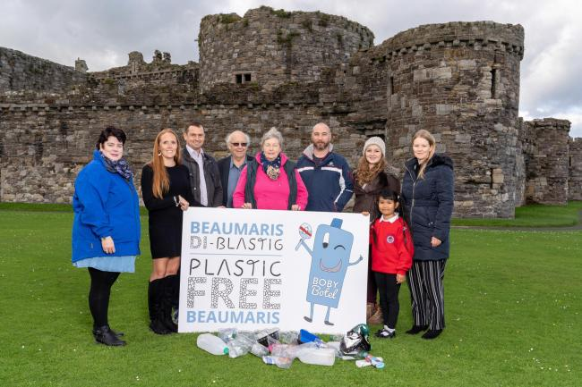 Plastic-free project members line up outside Beaumaris Castle.