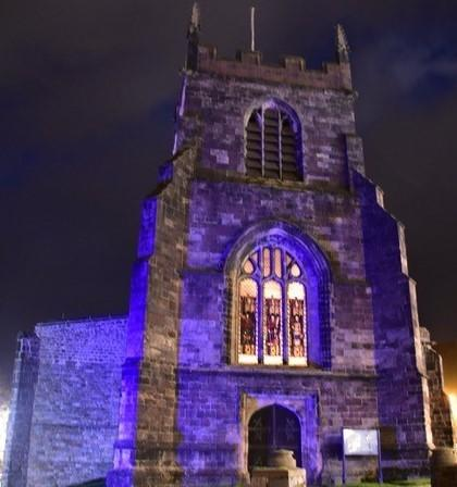 Bangor Cathedral bathed in purple
