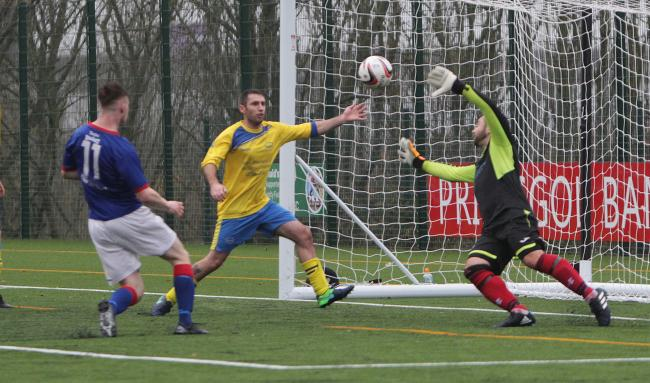 Dylan Summers-Jones nets for Bangor 1876 against Llanystumdwy (Photo by Richard Birch)