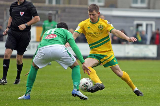 Darren Thomas netted twice for Caernarfon Town at Goytre United