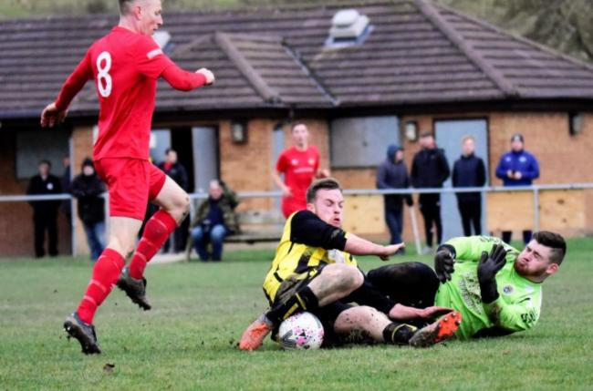 Action from St Asaph City's cup defeat to Denbigh Town (Photo by Steve Whitfield)
