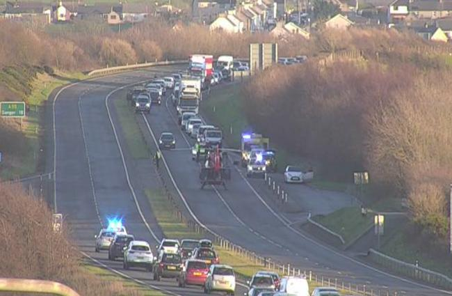 Air ambulance lands on the A55. Image: Traffic Wales