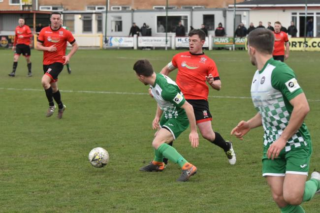Action from Porthmadog's draw at Prestatyn Town (Photo by John Pickles)