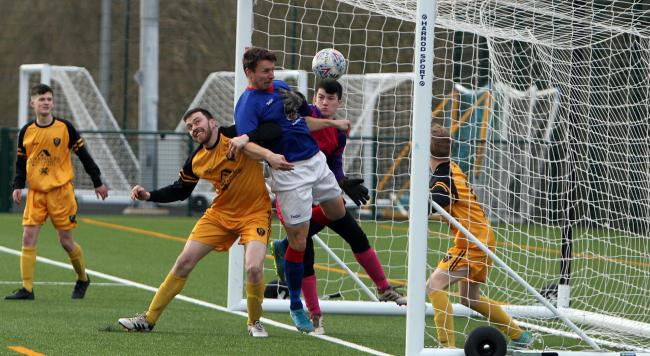 Les Davies nets one of his three goals for Bangor 1876 (Photo by Richard Birch)