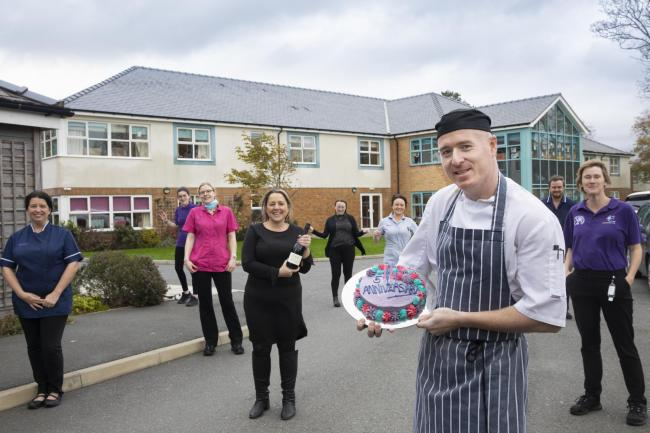 Bryn Seiont Newydd chef Richard Thompson holds a birthday cake with staff (front from left)  Deborah Parry, BSN manager Sandra Evans, Nia Davies Williams, Charlotte Foad-Owen, Sadie Davies, Gwern Larson, Sioned Jones and Debbie Owen. Picture: Mandy Jones