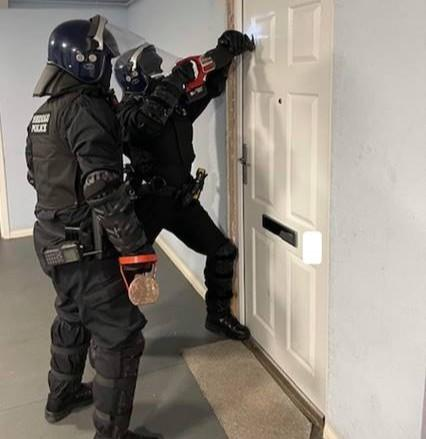 Officers carrying out a drugs search warrant at an address in Bangor on Thursday. Picture: NWP Gwynedd North/Facebook