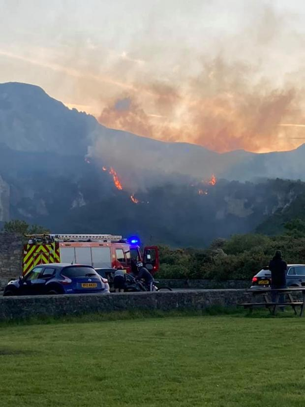 North Wales Chronicle: Jordan Love captured these dramatic photos of the blaze ripping through Holyhead Mountain