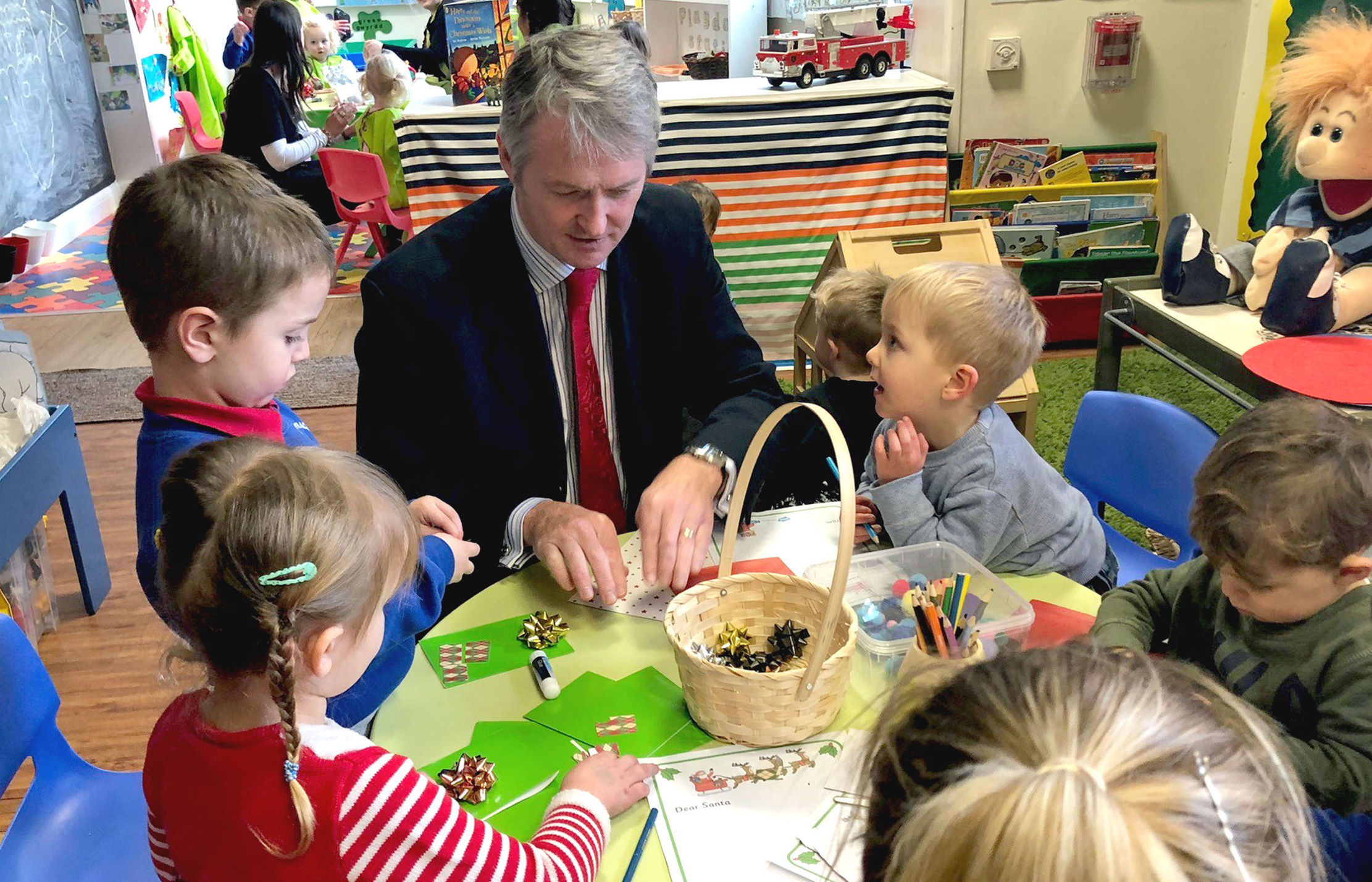 Huw Irranca-Davies Minister for Children and Social Care with a group of children. Picture: Welsh Government/PA