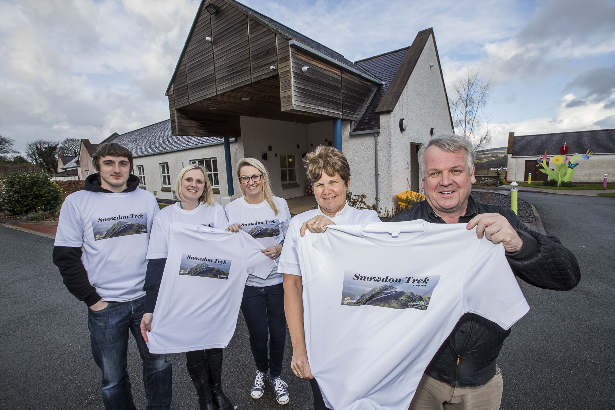 Alana and Sioned Jones at Ty Gobaith with Snowdon Trek t-shirts with Anthony Jones and fundraisers Hannah Penney and Amanda Jones.