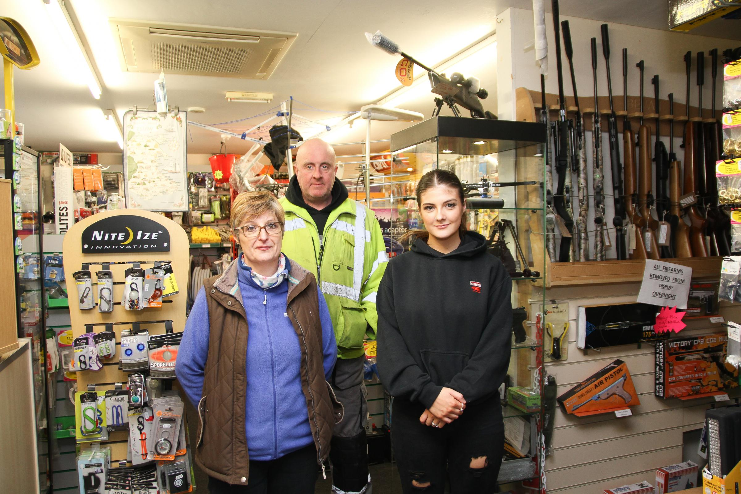 "Tracey, Neil and Maisie Bevan, feel the town of Llangefni has been ""forgotten about"" since floods took place there in November. PICTURE: Kerry Roberts."