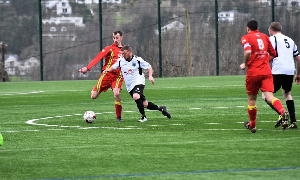 Arriva Bangor's Scott Hughes (white) in action earlier on in the season. PICTURE: Wynne Evans