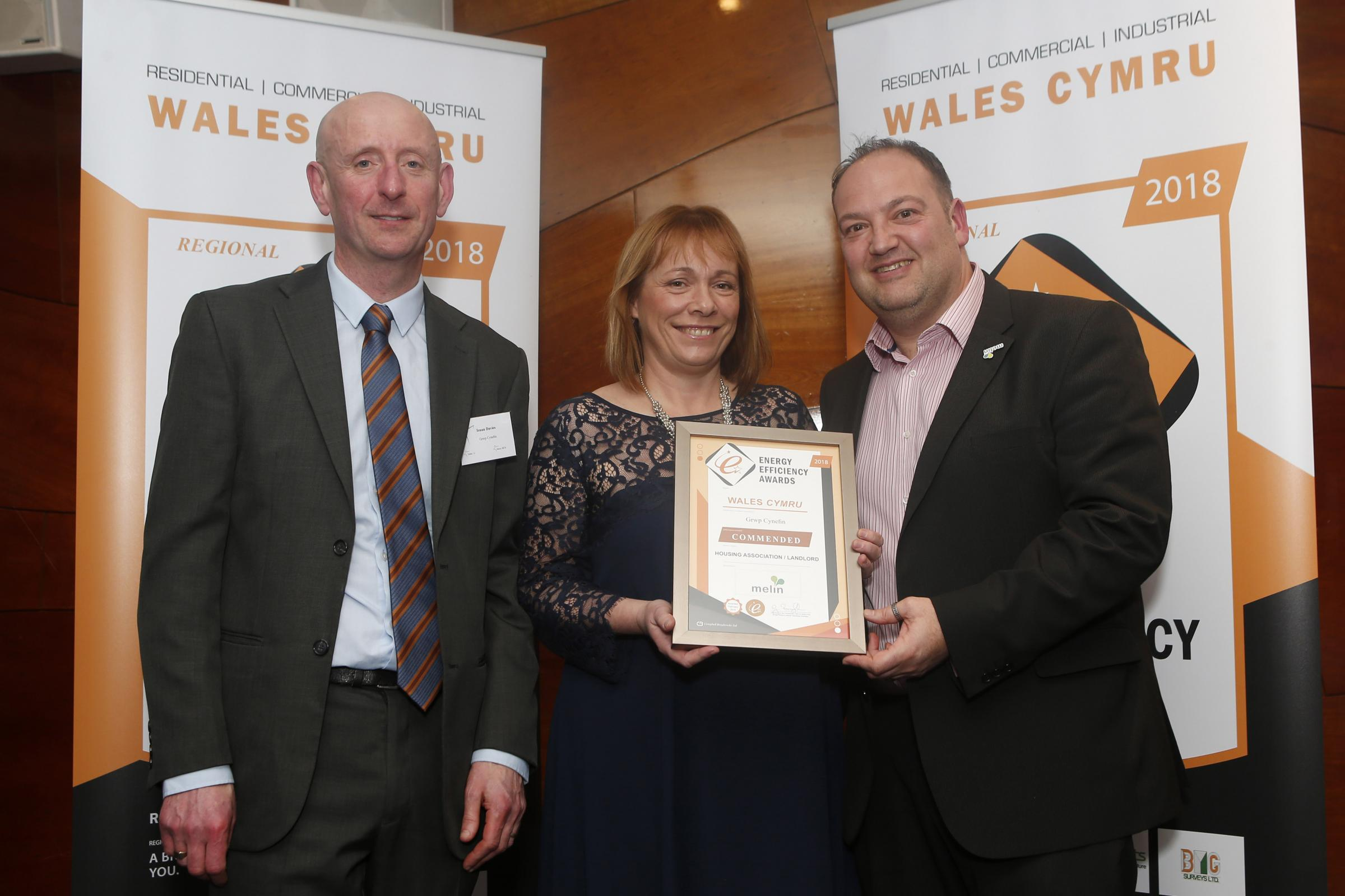 Energy award: From left: Ieuan Davies and Carina Roberts are presented a certificate of high commendation in the housing association category.