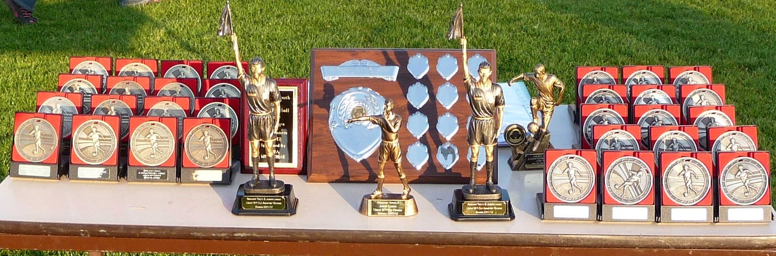 Under 18 Youth Cup shield, trophies and medals from 2011/12 season. PICTURE: Anglesey Junior Football League.