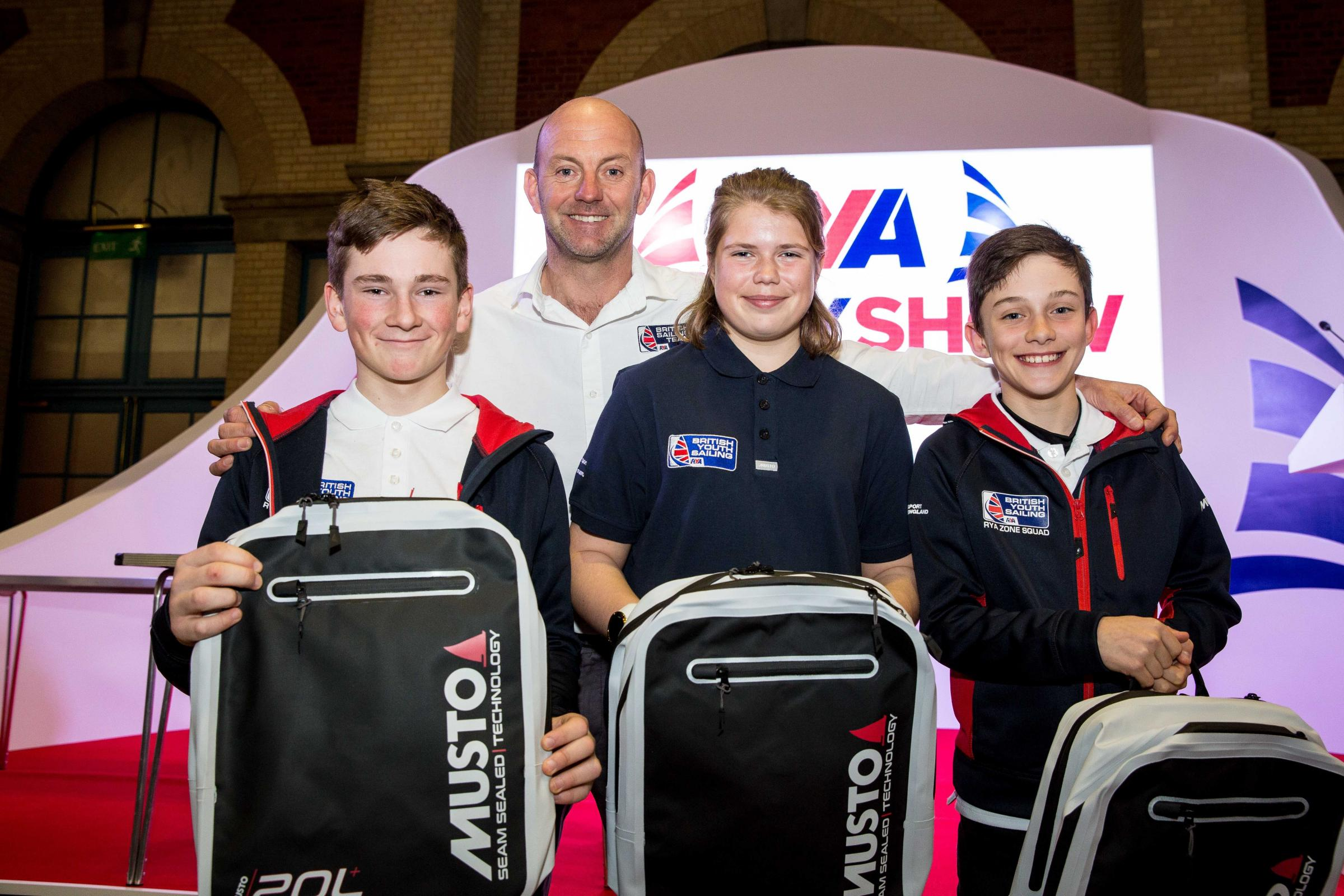 Ian Walker MBE presents awards to competition winners Ed Baker, 14, Catrin Williams, 15 and David Bromilow, 12. PIC: Emily Whiting.
