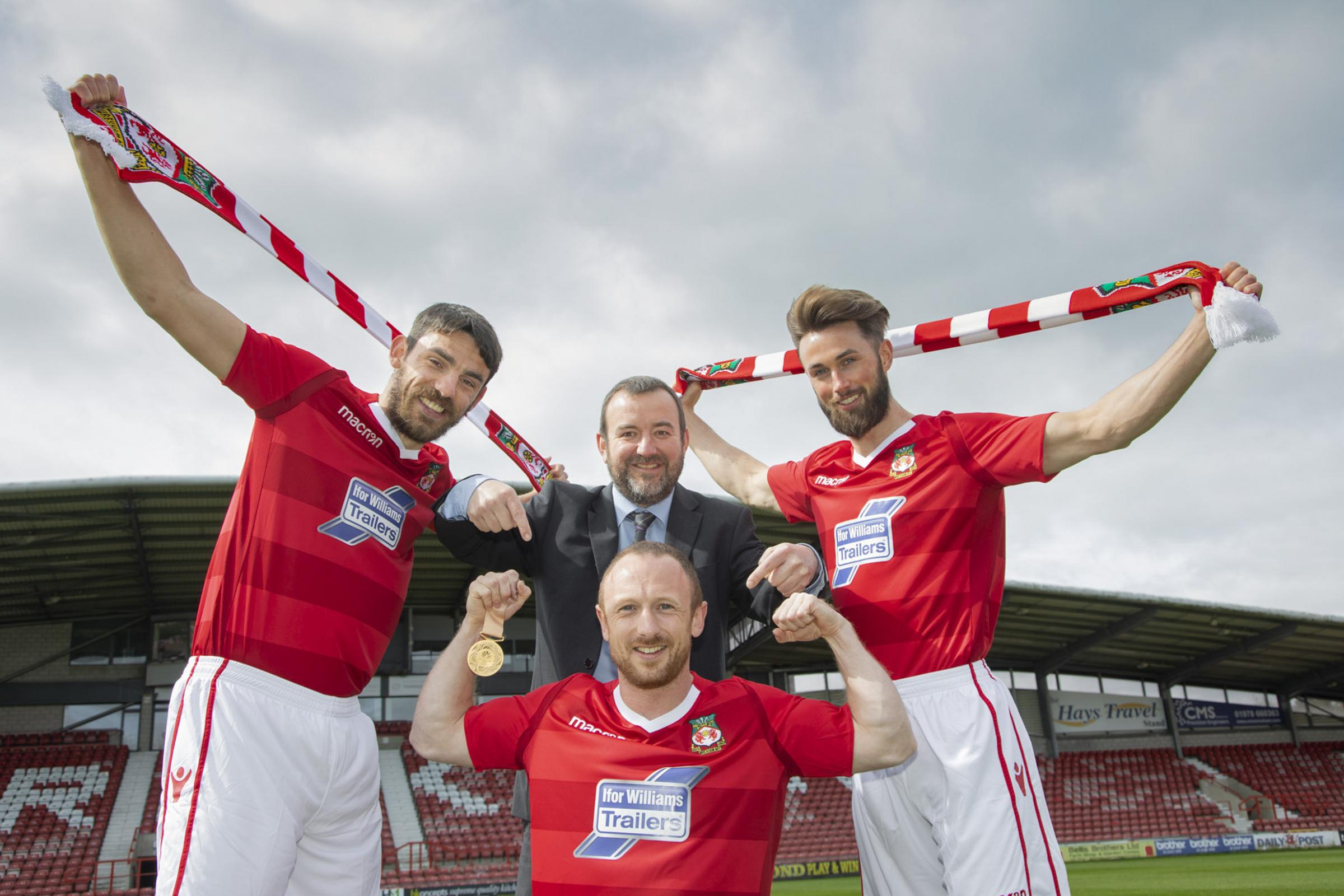 Pictured: Ifor Williams Trailers sponsor WFC.... Pictured  is Welsh weightlifter Gareth Evans with his gold Medal  and  ( L/R) WFC Player Shaun Pearson, Richard Hughes, HR Manager at IWT and WFC Player Chris Holroyd.