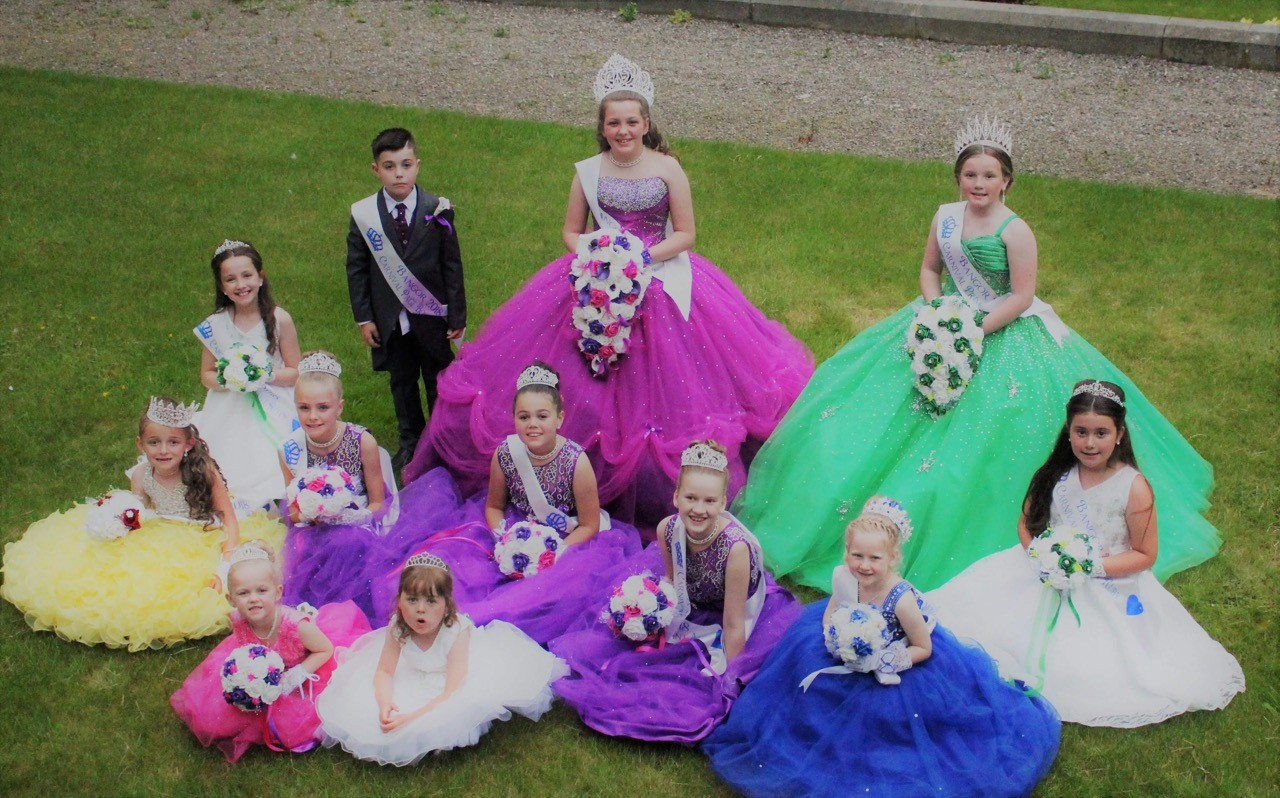 Queen Libby, Princess Miley, Libby's pageboy Archie and Miley's attendant Roxy, Rosebud Daisy, Libby's attendants, Grace, Honey & Amy, Petal Sera, and Mileys attendant Ruby.