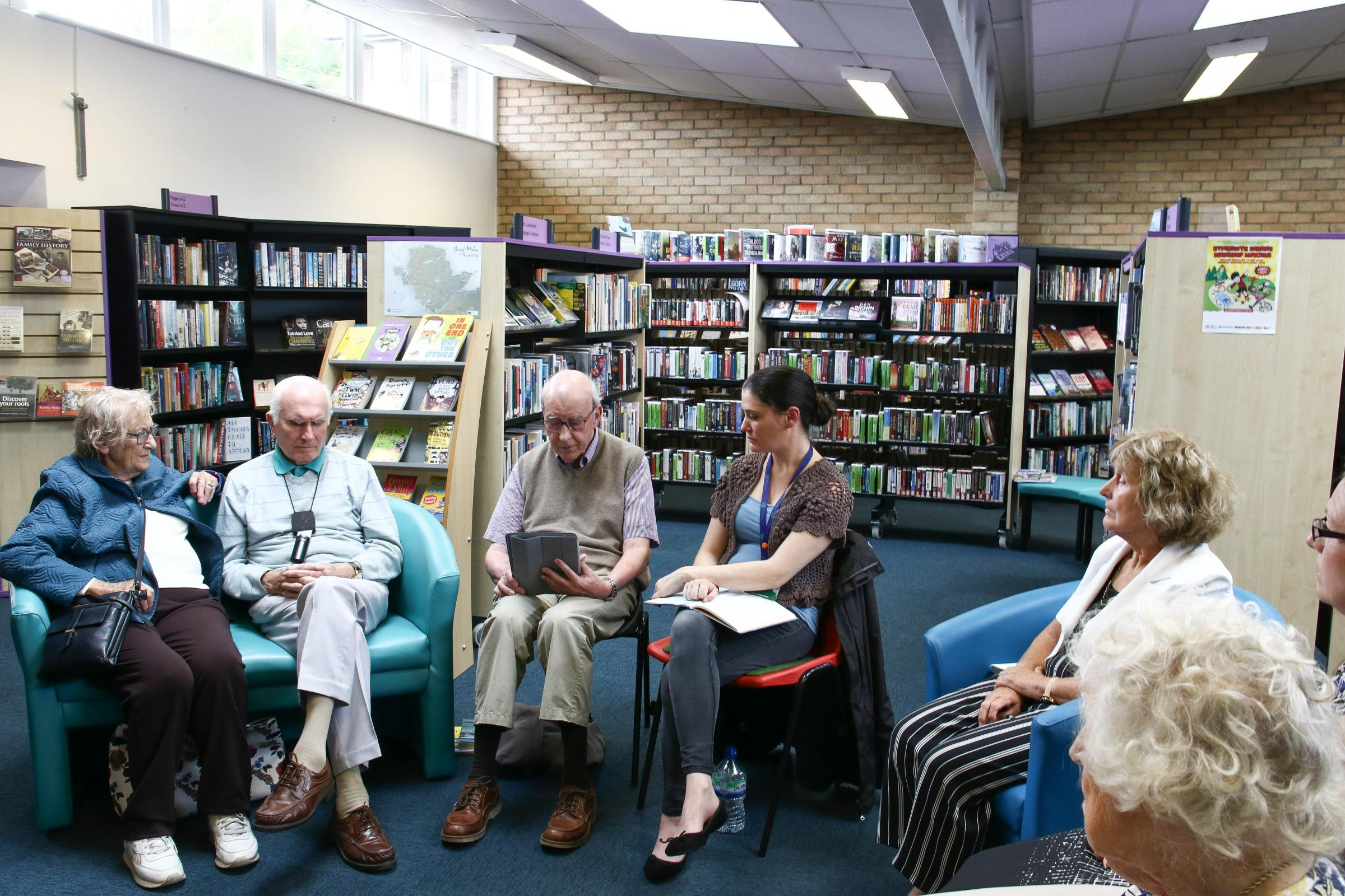 The sight loss book group group meeting at Menai Bridge library