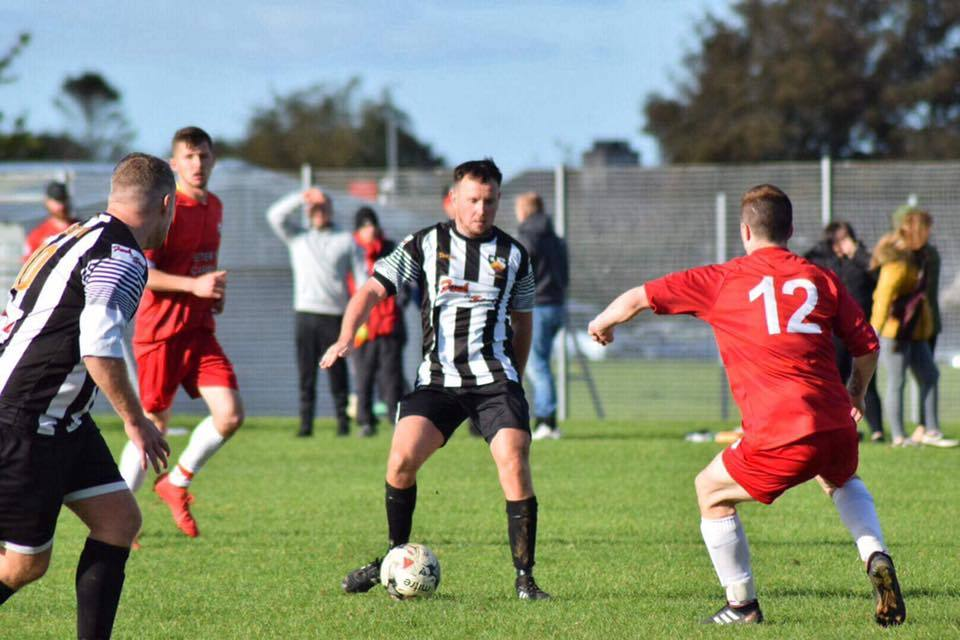 Caergybi (black and white) took on Cefni on Saturday and came away 4-1 winners. PICTURE: Caergybi FC.