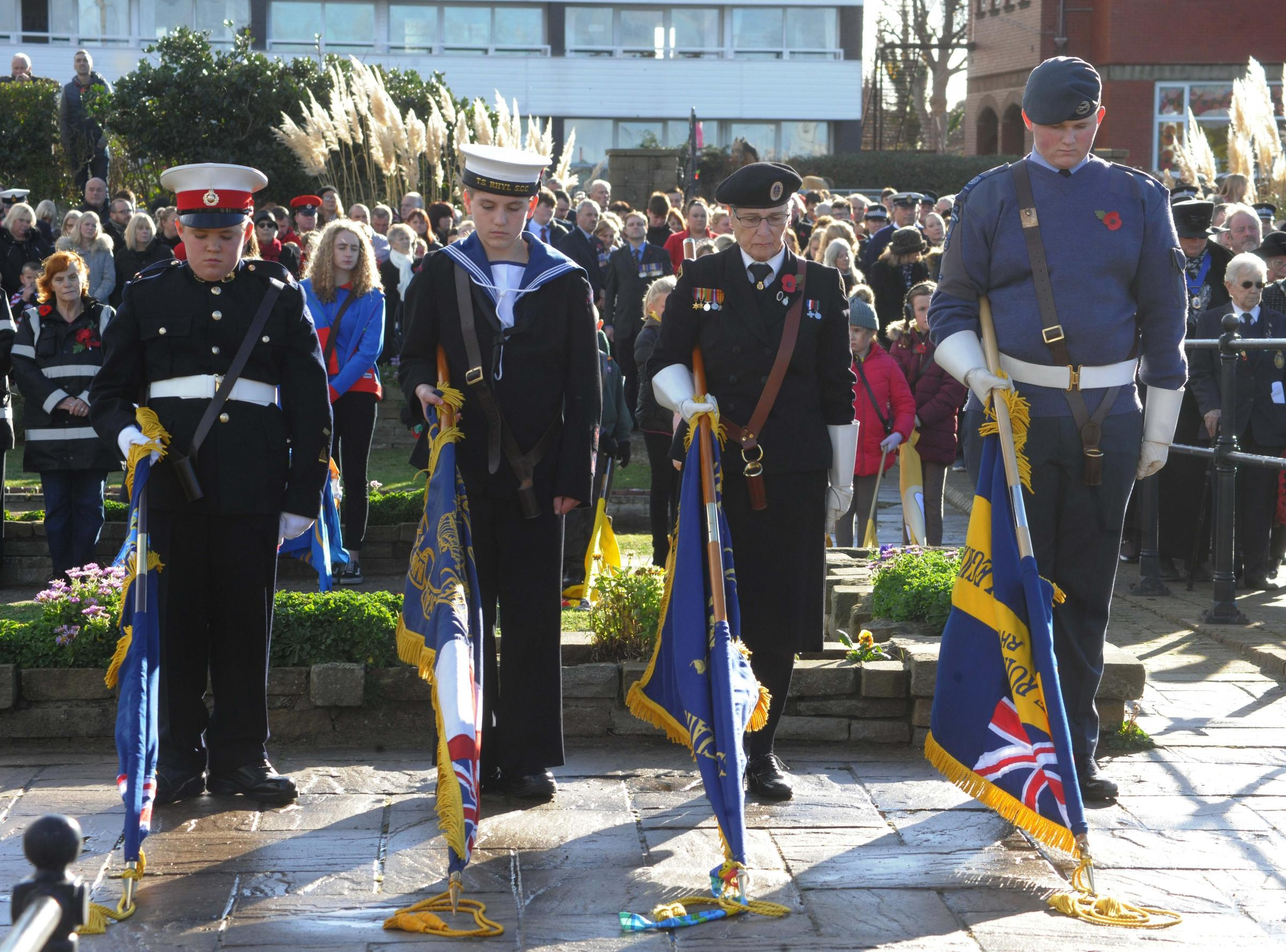 Colours are dipped at the start of the two-minute silence. Picture: PHIL MICHEU