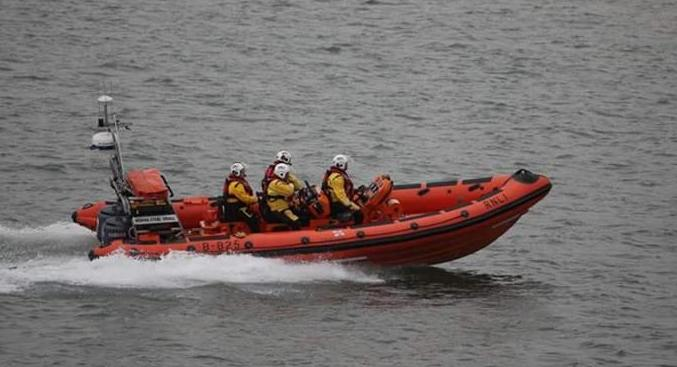 The Beaumaris lifeboat team assisted in rescuing the two jet skiers.