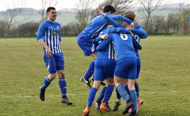 Hotspur Reserves celebrate Owain Roberts' late winner. PICTURE: Wynne Evans.