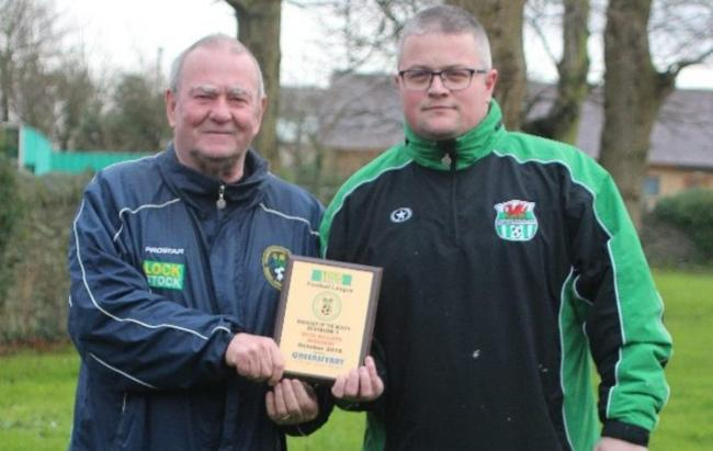 Bodedern Athletic manager Ricky Williams receiving his monthly award