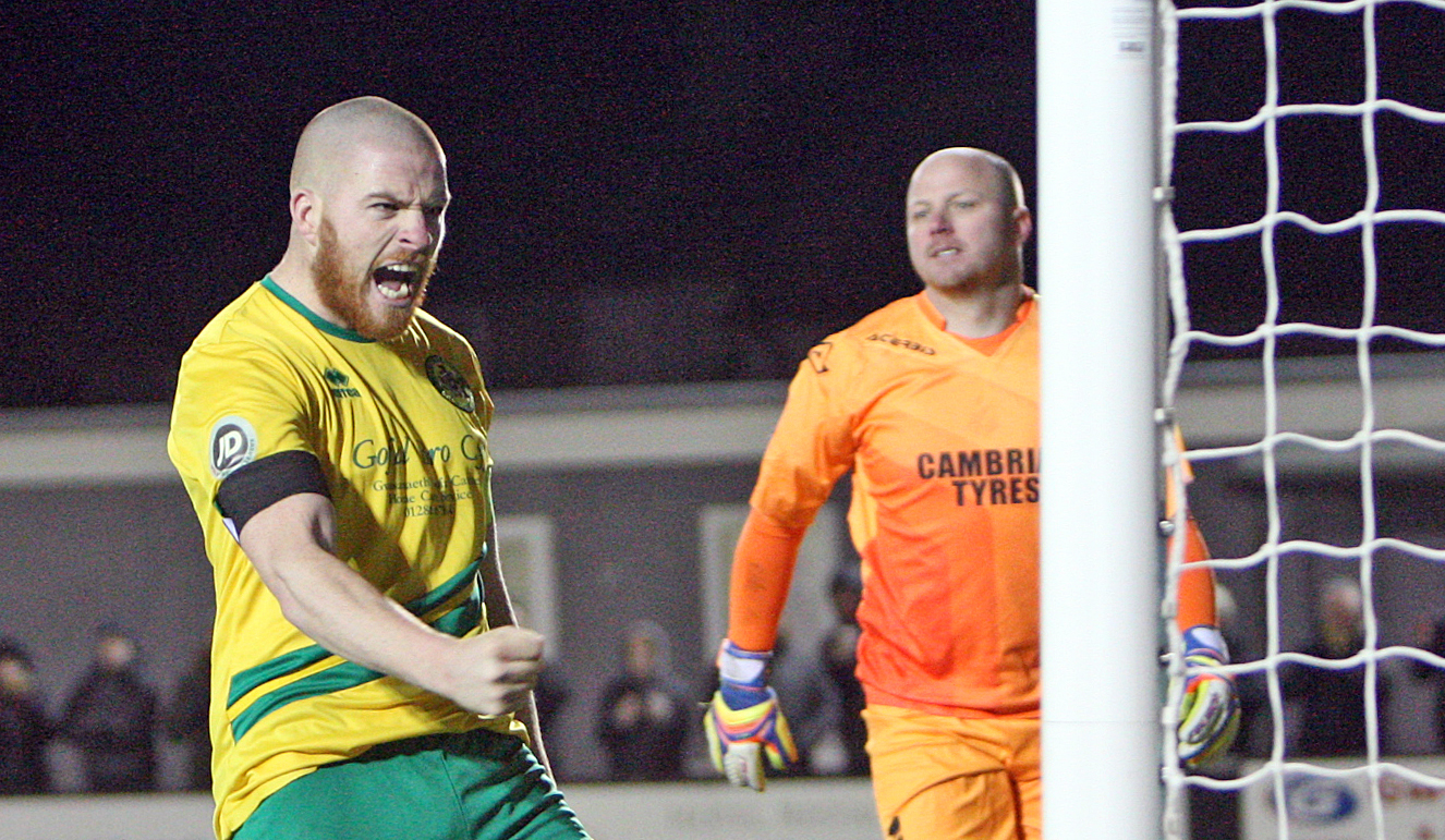Caernarfon Town skipper Nathan Craig celebrates a goal (Photo by Richard Birch)